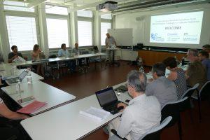participants listen to presentation